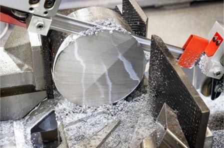 Metalworking saw operator