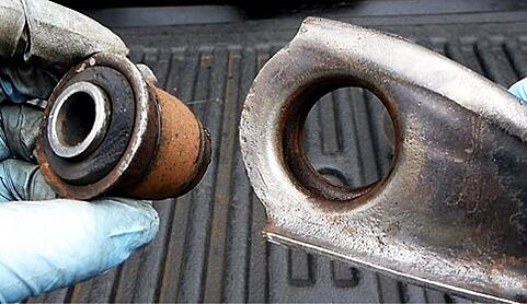 Taking apart rusted bushing component